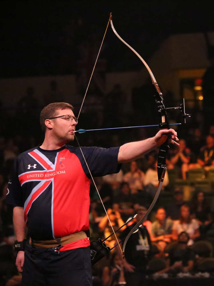 Paralympic athlete from the United-Kingdom team doing archery